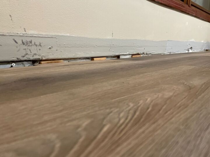 q use caulking fill floor gaps and liquid nails to re adhere baseboards