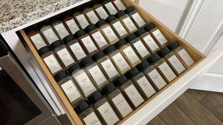 s 25 storage hacks that will instantly declutter your kitchen, Spice Drawer Organizer