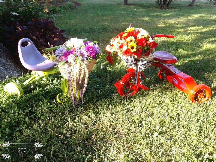 how i recycled tricycles into charming yard decor, Beautiful Yard Art