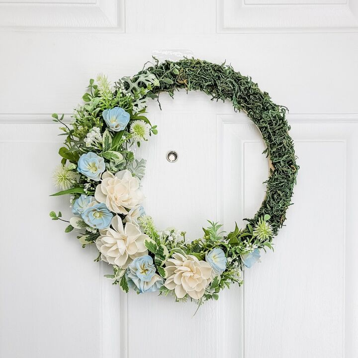s 15 awesome summer wreaths that will make your front door look so cute, A textured mossy wreath