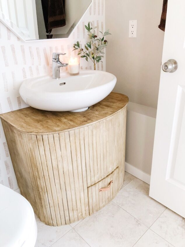 s 16 shocking furniture upcycles with stunning results, Transform a crib into bathroom vanity