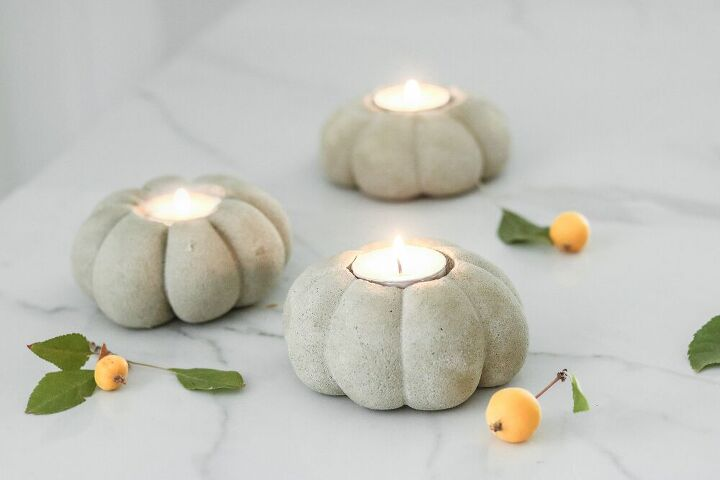 s 18 of the best budget friendly fall ideas it s time, These lovely concrete pumpkin candles