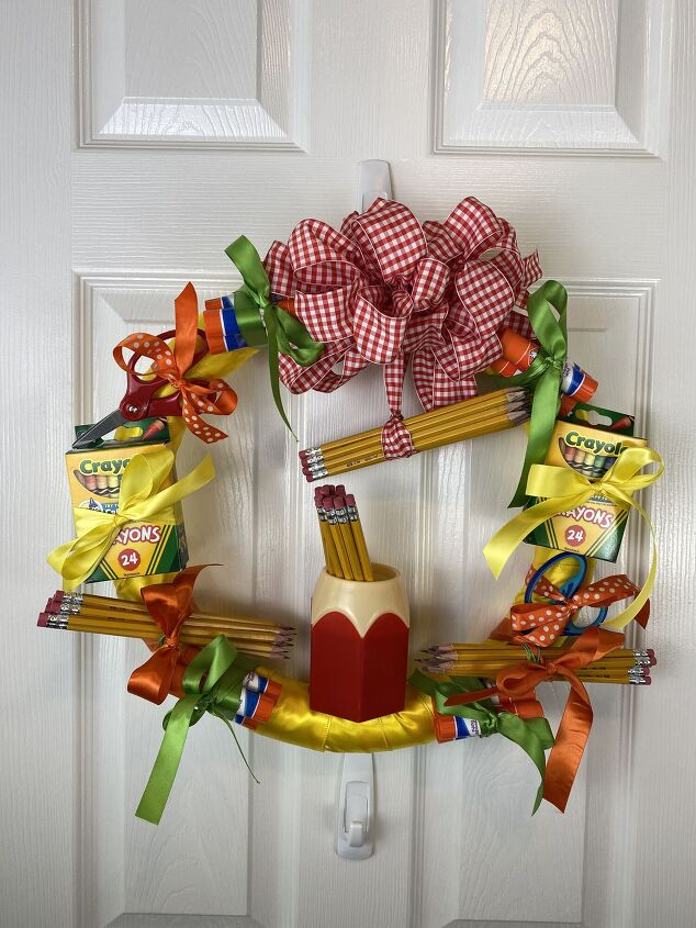 s 10 back to school ideas that are so darn cute, A whimsical school supplies door wreath
