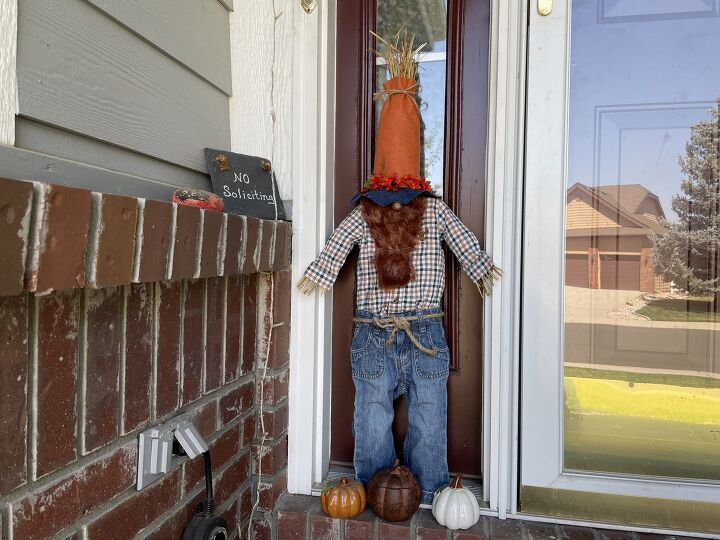 s how to make cute fall porch decor using a pool noodle and a onesie, Fall Scarecrow Gnome