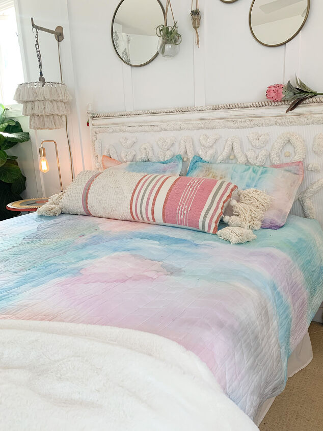 s 14 ways to upgrade your bedroom on a budget, These vibrant watercolor shams and blanket