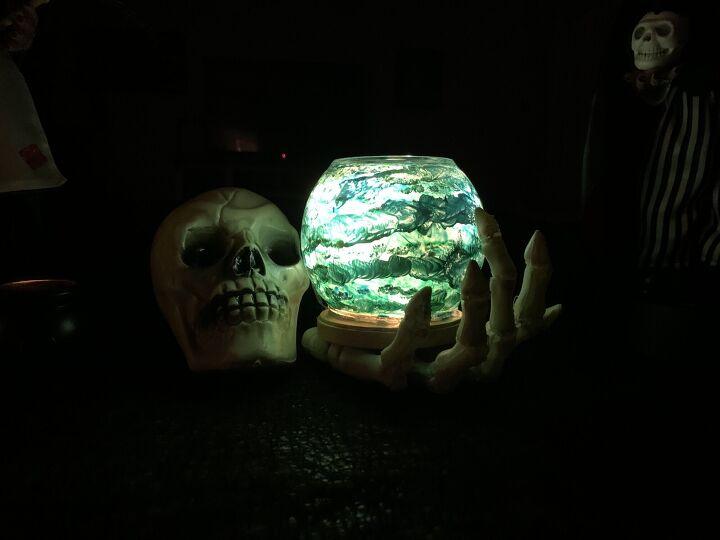 diy skeleton hand holding crystal ball