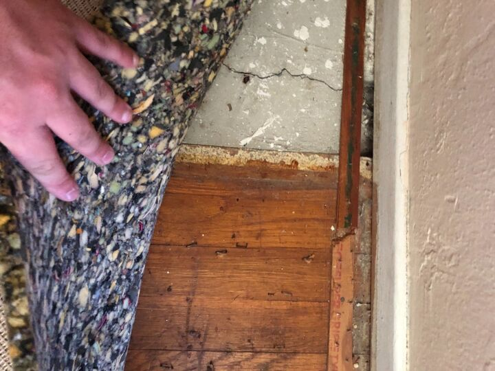 q how do we deal with concrete that is flush to hardwood floor