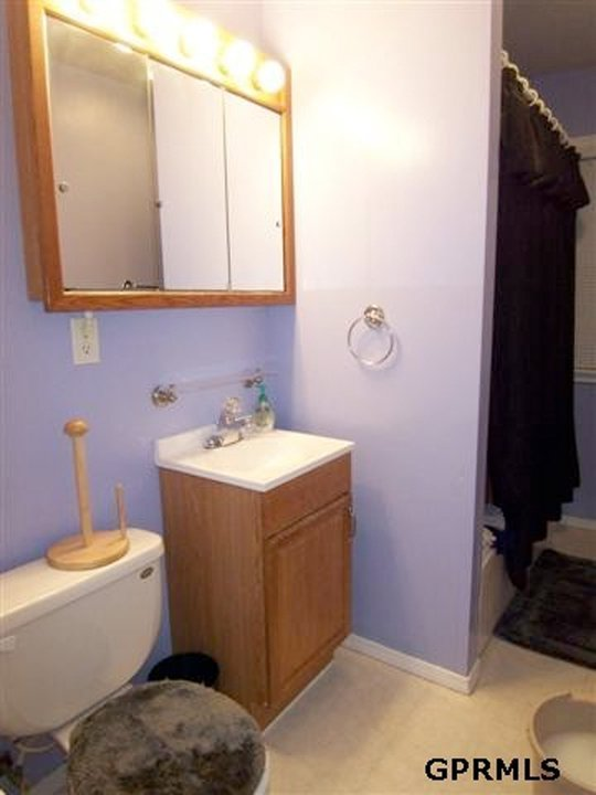 Bathroom before from MLS listing.