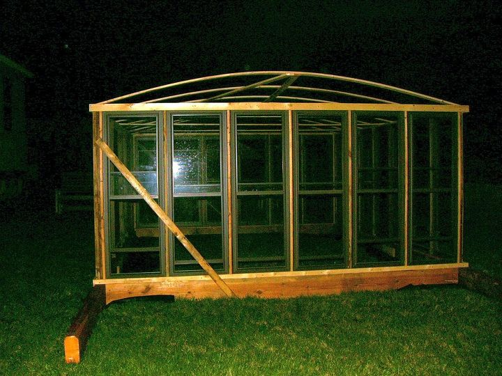 the green house my husband made from mostly all recycled stuff, gardening, our green house