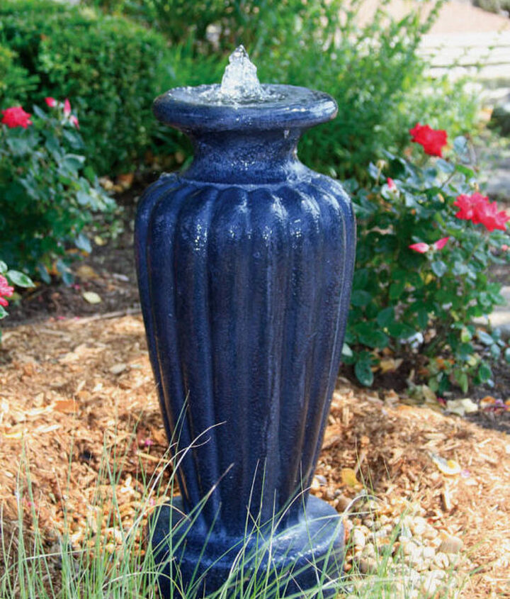 A classic blue urn for lends traditional elegance to a flowerbed.