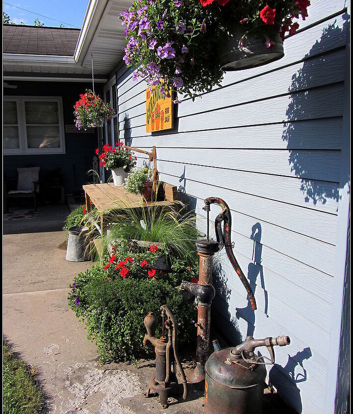 my potting bench watering can collection amp pumps, electrical, gardening, outdoor furniture, painted furniture, rustic furniture