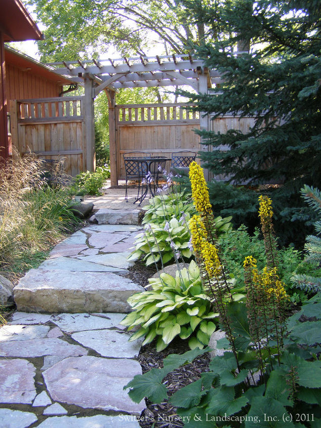 A noticeable change in the space.  Changing the material of the walkway emphasizes the change in spaces. A clear transition has been established between the front & back yard.