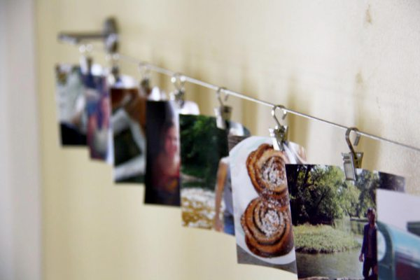 ikea hack curtain wire to photo display, home decor, repurposing upcycling, Turn a curtain wire from Ikea into a fun photo display