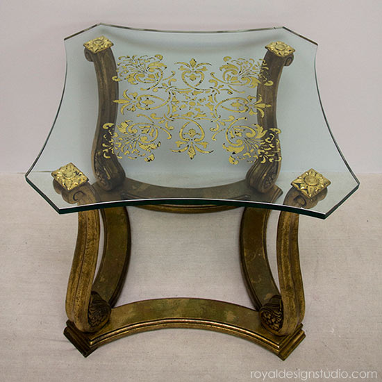 http://www.royaldesignstudio.com/blogs/how-to-stencil/12181117-stencil-how-to-reverse-stenciling-and-gilding-on-glass