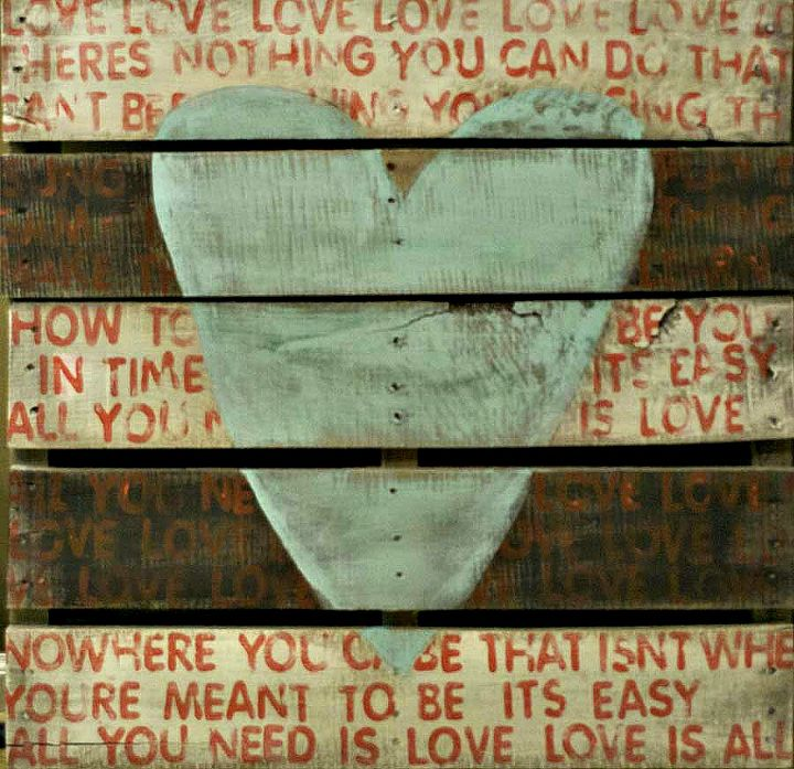 """Love """"All You Need is Love"""" by the Beatles. The lyrics are hand stamped in red across the white & black striped slats. If you can't find a pallet, you can make one,too."""
