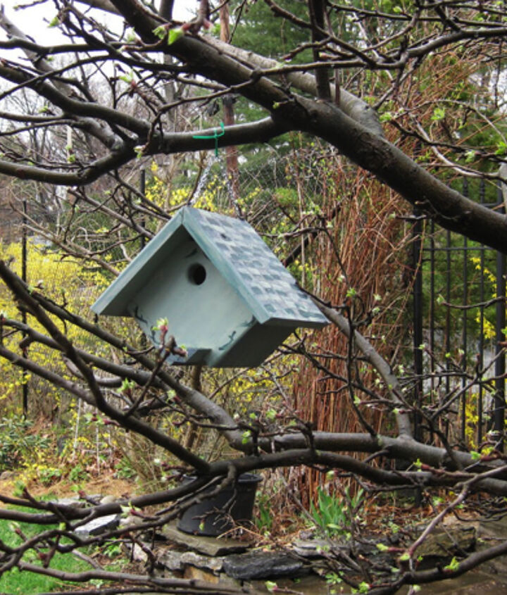 Keeping some birdhouses directly out of the garden and in a more natural setting adds to the charm along with helping birds to feel more secluded and safe.