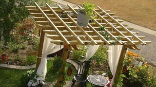 q i want to build a pergola, diy, outdoor living, woodworking projects, Top view gives you a better idea of what we did to make the top We just ripped 2x4x8 in half lengthwise to make the top