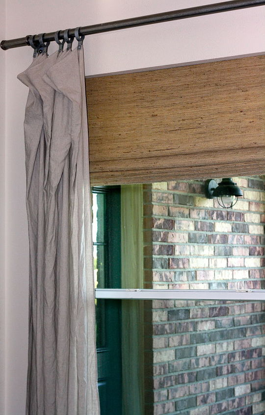 The curtains are painter's drop cloths and the rods are chain link fencing posts...