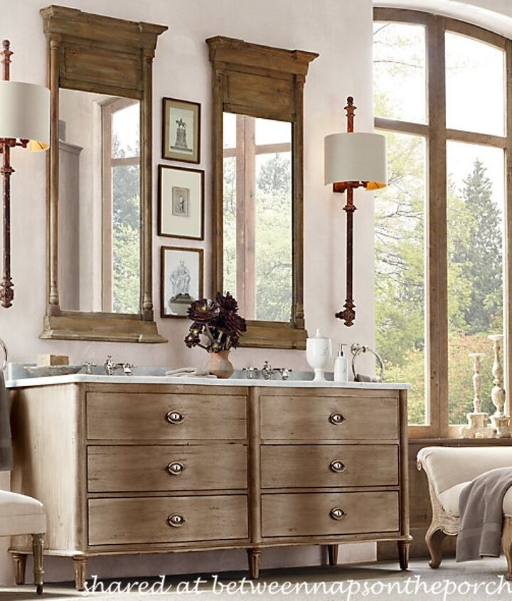 "Here's Michael's ""inspiration room"" from Restoration Hardware.  Michael purchased the mirror and the sconces. Will her existing vanity work or should she replace them?  You'll find more information in the post."