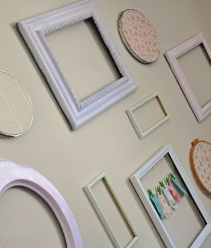 I also used a few old embroidery hoops and covered them with fabric to hang on the wall