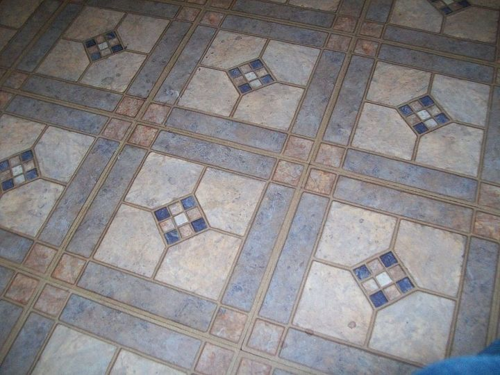 the tiles of doom, not in bad shape or ugly, but do not belong in a large living room and dinning room.
