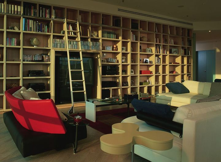 Floor to ceiling and window to column built-in bookshelving.