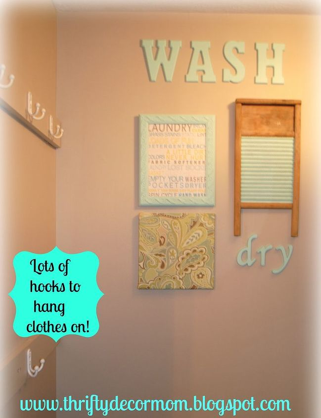 laundry room, cleaning tips, laundry rooms, shelving ideas, storage ideas, Lots of hooks for hanging clothes right out of the dryer Added fun artwork to brighten up the space