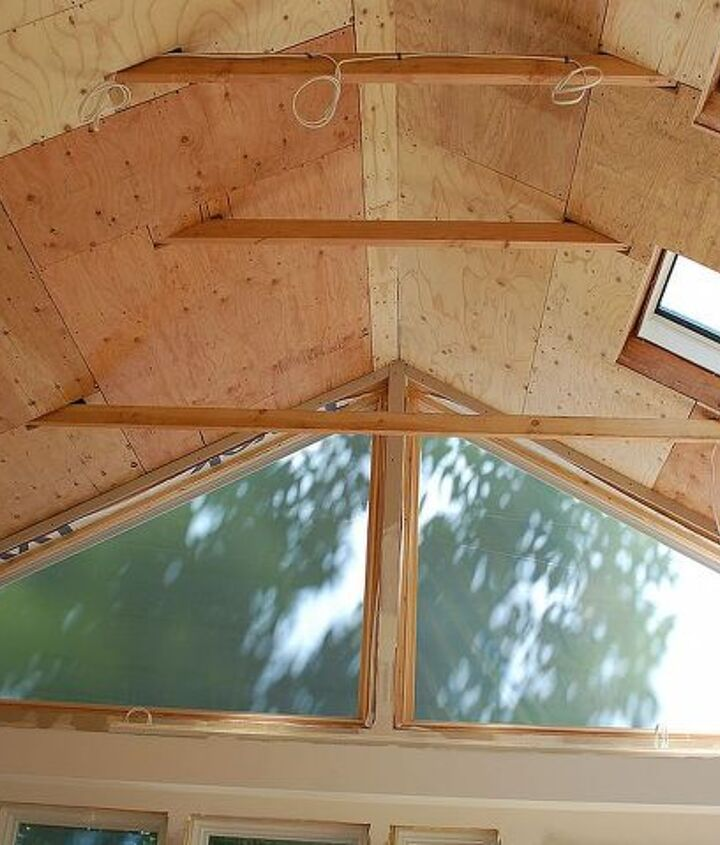 """Raised 2 colar beams.  Did not want to sheetrock and paint ceiling so we ended up with a vertical 4"""" tongue and groove board.  Gives the room a dated look.  Love it!"""