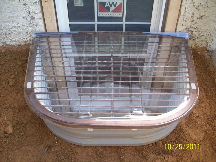 installing an egress window well for exiting from the basement safely, basement ideas, concrete masonry, windows, Finished egress window with well
