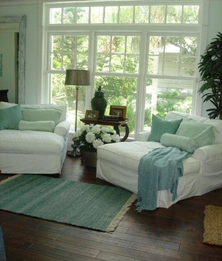 Adding sky blue to all white living rooms is an easy way to give it a new look. Touches of sea green look great in the mix.