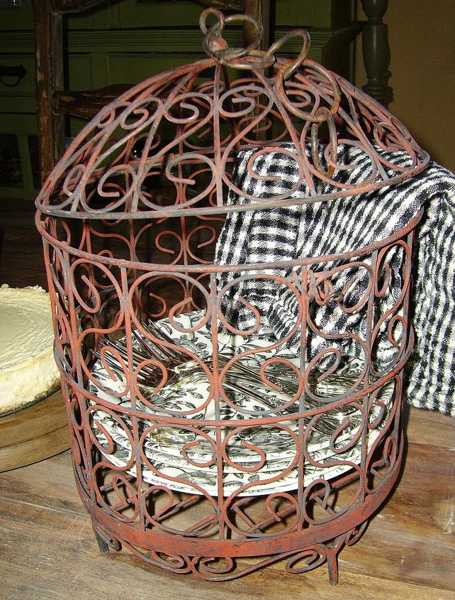 Birdcage used to hold dessert plates.  Note:  no bird has ever been in this cage.  It's decorative only...not for the birds!