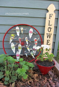 bike wheel plant label tag organizer, flowers, gardening, repurposing upcycling, The plant labels are alphabetized by letter and then attached with weathered clothespins to the wheel spokes