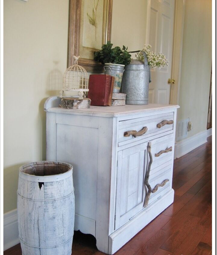 We used old branches from the yard as hardware in keeping with the rustic look