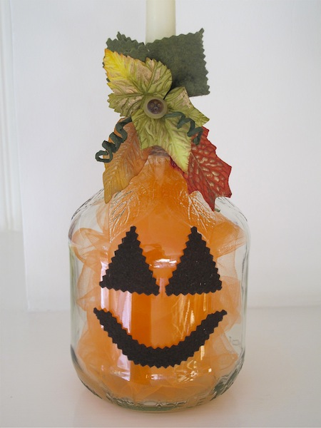 pumpkin re purpose project bottle into a pumpkin candle holder, crafts, halloween decorations, repurposing upcycling, seasonal holiday decor, Completed transformation from bottle to pumpkin