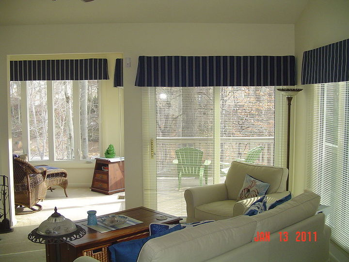 q suggestions for a huge wall from vaulted ceiling to lower level, home decor, home improvement, home maintenance repairs, how to, wall decor, Small sunroom off the living room I d like to echo the tall windows in that room by using tall thin mirrors on the staircase wall