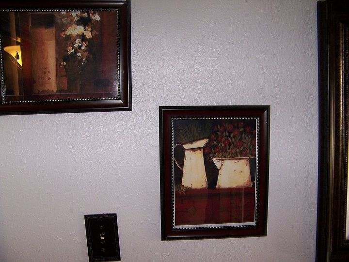 pictures on the walls were printed off the internet and placed in some nice frames, and color cordinated to the bathroom...