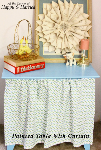 4. The Corner of Happy and Harried - Made this painted table with the curtain that is cute. But the DIY magic in this photo is the framed book page flower art! So in love with this!