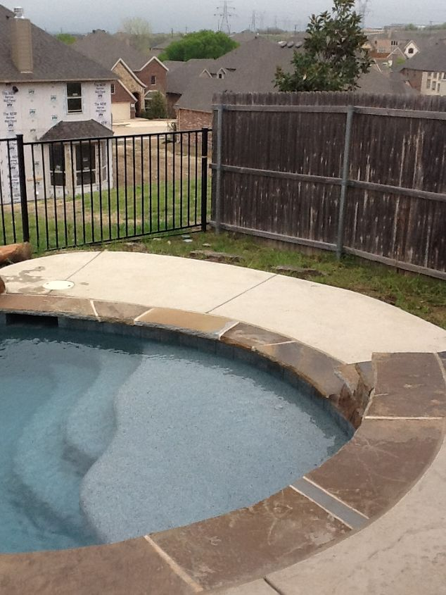 This is where you would enter the pool. I would like to put a bench over in the grassy area. I would like to change this to small rock as mulch in this area.