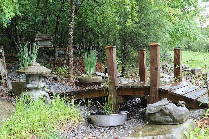 This small bridge is the entrance of my woodland garden. There was a constant wash out in this area so I created a dry creek bed to channel the run off where I needed it to go.