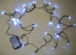 We currently use LED battery operated lights in our planters right outside our front door. During the day you can barely notice them and at night they add a lovely glow that can't be missed. A steal at Christmaslightsetc.com for $8.99