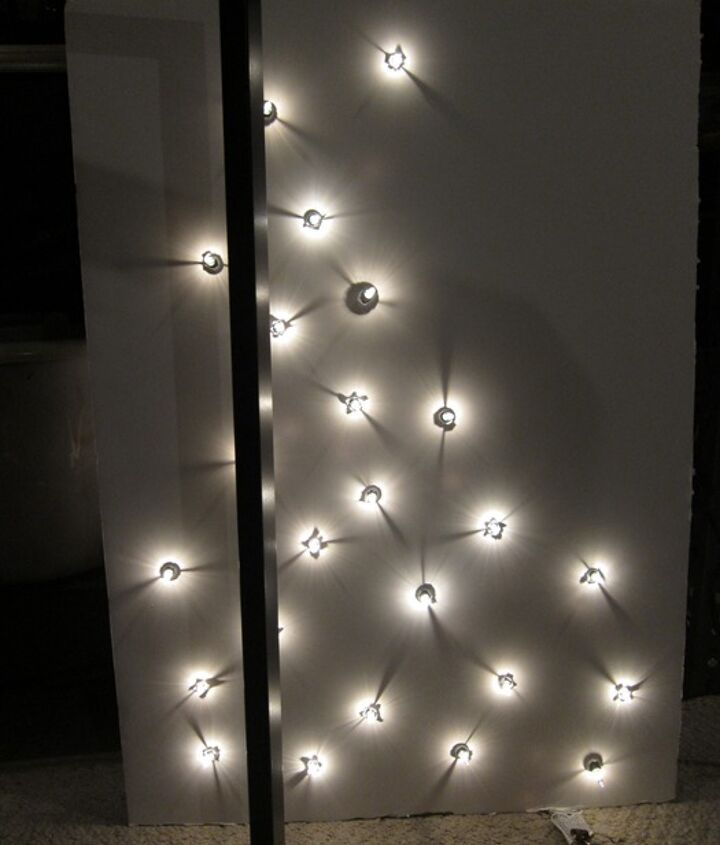 Use twinkle lights to create a unique holiday wall hanging. http://www.madiganmade.com/2011/12/make-lighted-ornament-tree-on-canvas.html