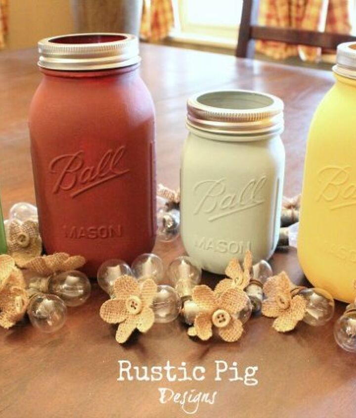 Painted Ball jars and bulbs with burlap flowers are ready to be put together to create a garland.