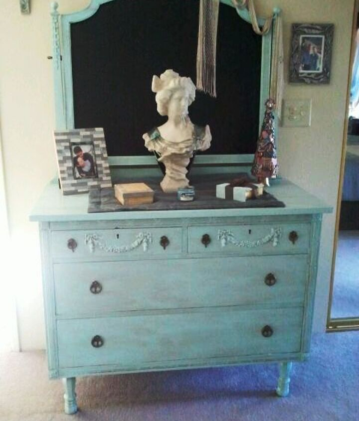 Viola! She's done! Valspar Crystal Aqua with bronze glaze. I replaced the casters with legs to give it a little height. Rather than replace the mirror I painted the backing with chalkboard paint.