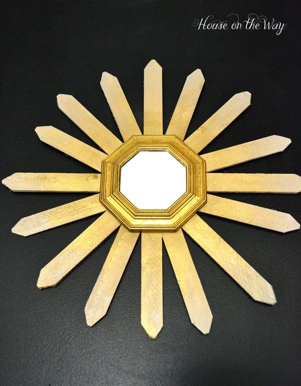 DIY Sunburst mirror is a great touch to the wall.