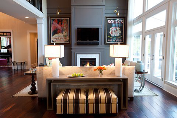 Greys look fab in the living room with cream and dark wood furnishings as seen in this living room!