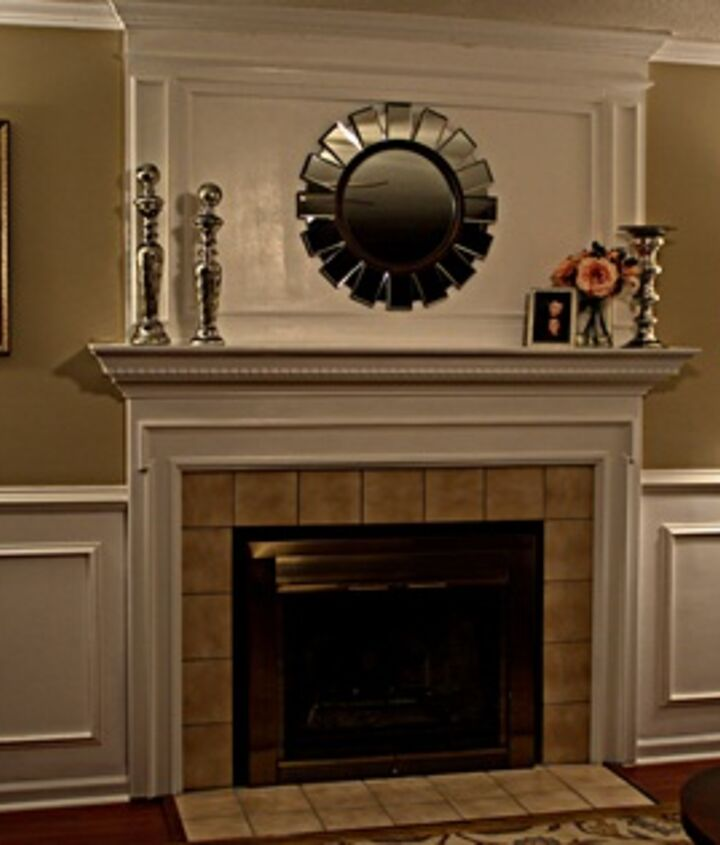 Our living room remodel included building a fireplace overmantle, installing wainscoting and crown moulding.