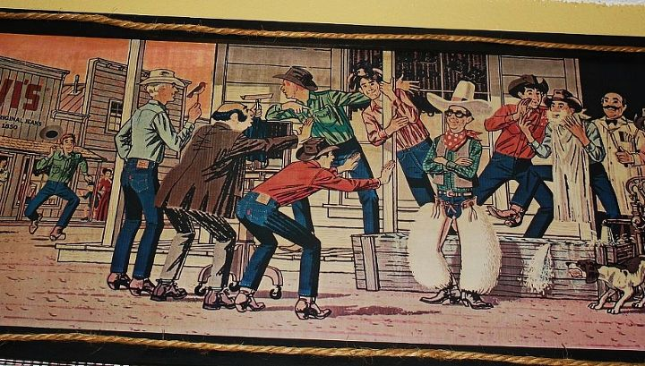 "Love these vintage Levi ads used them as valances in my ""western"" themed guest room."