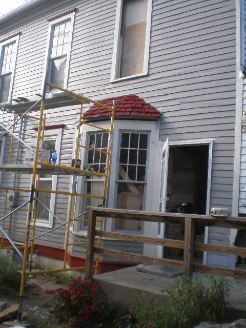 the bay windows really needed a new little roof...the other one was a huge, oversized doghouse gable roof that looked out of place and weighted down the windows.