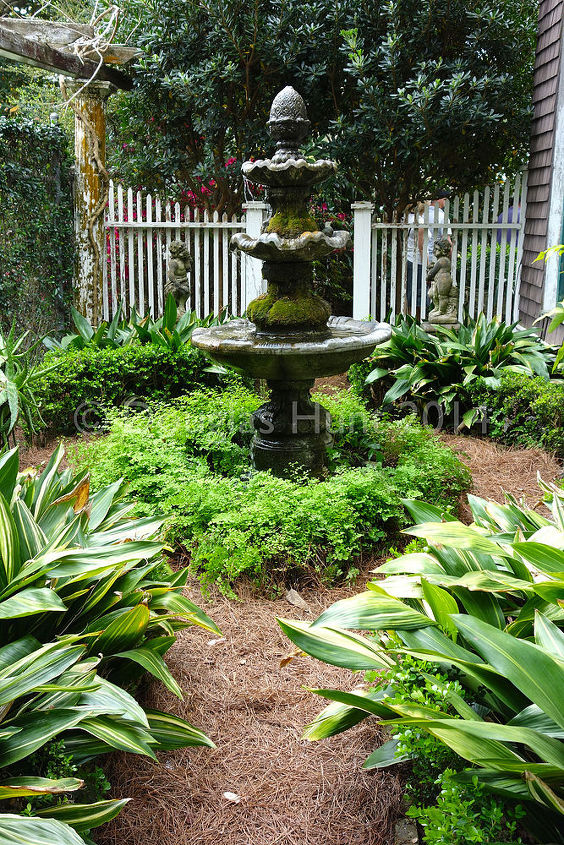 when secret gardens open their doors, flowers, gardening, outdoor furniture, outdoor living, A screened in porch filled with comfortable furniture overlooks this side yard