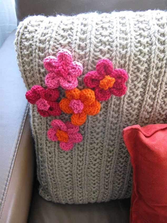 knitted cushion with knitted flowers, crafts